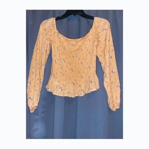 Yellow floral smocked long sleeve blouse